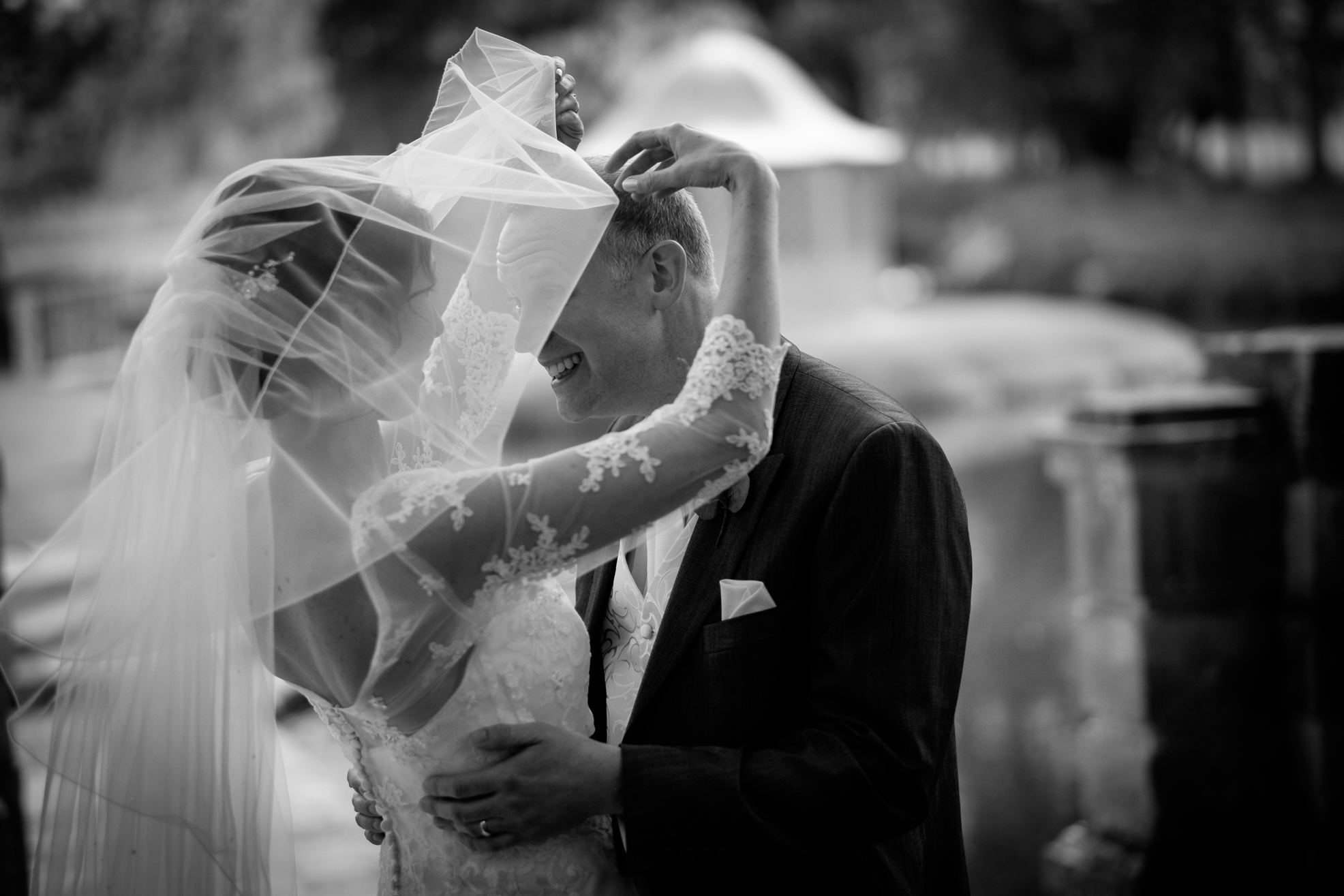 Bride and groom and veil