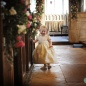 Harlton Church wedding near Cambridge - bridesmaid in the aisle