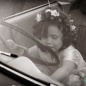 Little bridesmaid driving a classic car