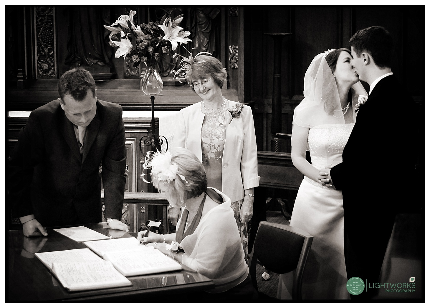 Register signing at a college wedding
