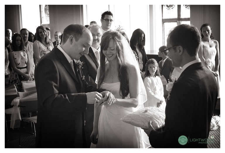 Madingley Hall Cambridge wedding exchanging rings