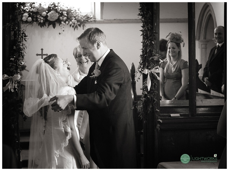Groom removing a bride's Veil