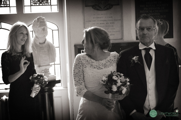 Wedding at a Cambridge chapel. Bride waiting for ceremony