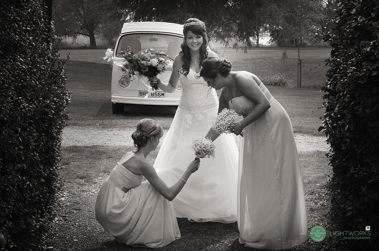 Bride arriving for her wedding at Creaksea Church Essex - VW Camper Van