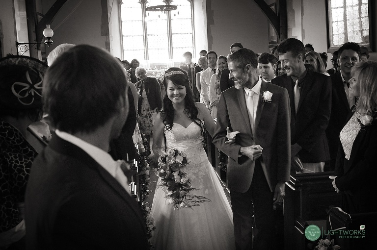Wedding at Creaksea Church Essex. Bride and groom see each other for the first time.