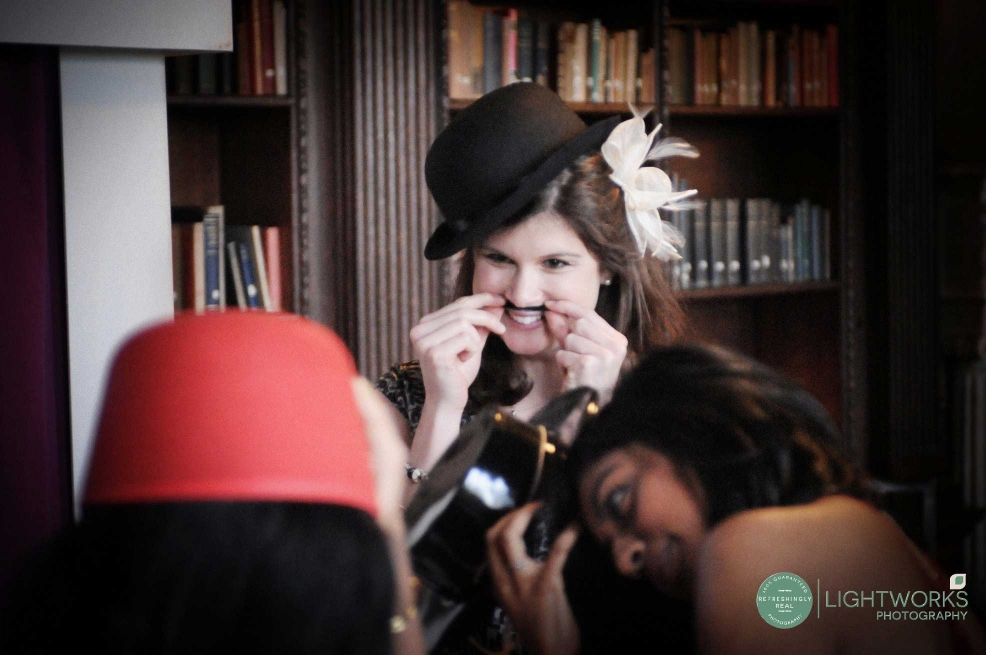 Wedding guest dressing up for a photo booth