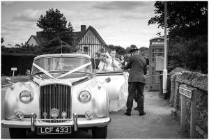 Bride getting into a wedding car
