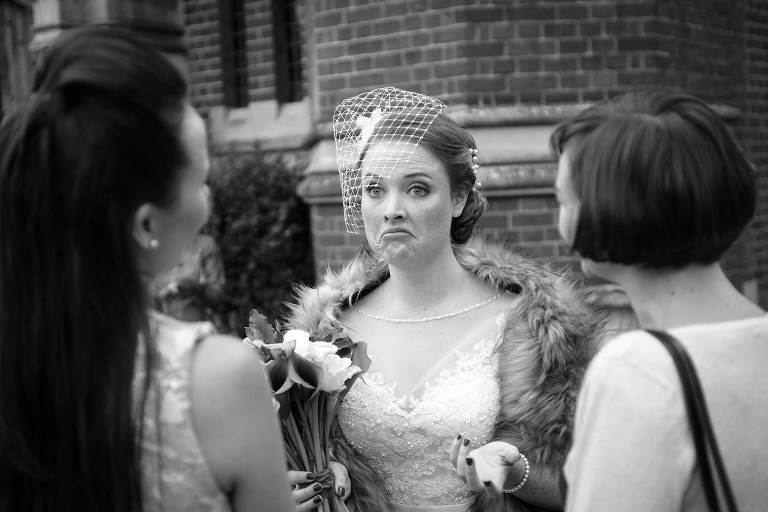 bride with funny expression. Camridge college wedding