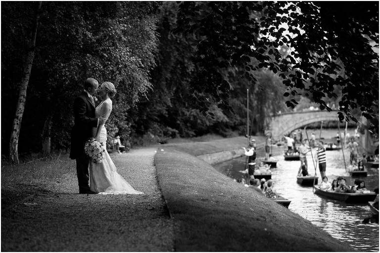 Bride and groom by the river Cam