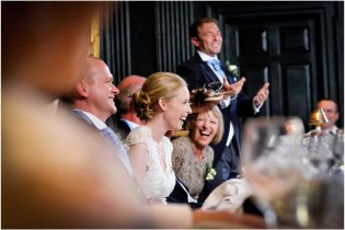 Wedding speeches in the hall at Queens College Cambridge